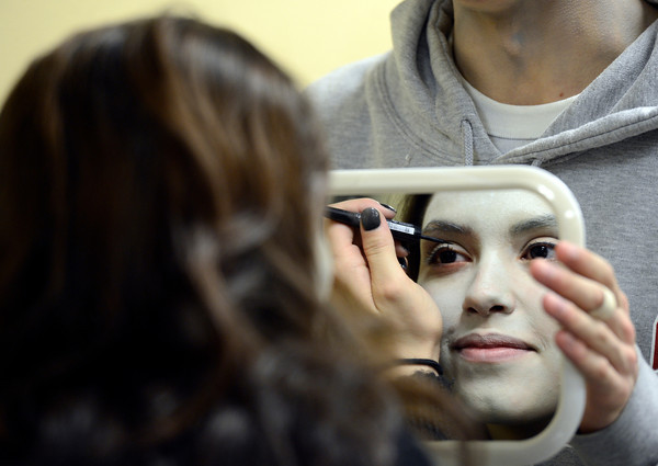 "Fairview High School junior Rebecca Viale applies makeup before filming an Awareness Drive week zombie video on Tuesday, Feb. 19, at Fairview High School in Boulder. The event was part of a video to bring awareness to problems such as substance abuse, cutting, stress, depression and eating disorders. For more photos and video of the zombie invasion at Fairview High School go to  <a href=""http://www.dailycamera.com"">http://www.dailycamera.com</a><br /> Jeremy Papasso/ Camera"