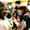 "Fairview freshman Philippa Keosheyan, 14, gets a final touch-up of blood by makeup artist Kristy Pike during the filming of an Awareness Drive week zombie video on Tuesday, Feb. 19, at Fairview High School in Boulder. The event was part of a video to bring awareness to problems such as substance abuse, cutting, stress, depression and eating disorders. For more photos and video of the zombie invasion at Fairview High School go to  <a href=""http://www.dailycamera.com"">http://www.dailycamera.com</a> DAILY CAMERA/ JESSICA CUNEO."