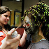 "Theatrical Costumes Ect. employees Kristy Pike, left, and Danica Minor, at center, apply makeup to Fairview High School freshman Sydney McViker during the filming of an Awareness Drive week zombie video on Tuesday, Feb. 19, at Fairview High School in Boulder. The event was part of a video to bring awareness to problems such as substance abuse, cutting, stress, depression and eating disorders. For more photos and video of the zombie invasion at Fairview High School go to  <a href=""http://www.dailycamera.com"">http://www.dailycamera.com</a><br /> Jeremy Papasso/ Camera"