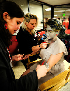 Theatrical Costumes Ect. makeup artists Kristy Pike, 23, left, and Danika Minor, 27, make Fairview freshman Philippa Keosheyan, 14, a zombie during the filming of an Awareness Drive week zombie video on Tuesday, Feb. 19, at Fairview High School in Boulder. The event was part of a video to bring awareness to problems such as substance abuse, cutting, stress, depression and eating disorders. For more photos and video of the zombie invasion at Fairview High School go to www.dailycamera.com DAILY CAMERA/ JESSICA CUNEO.