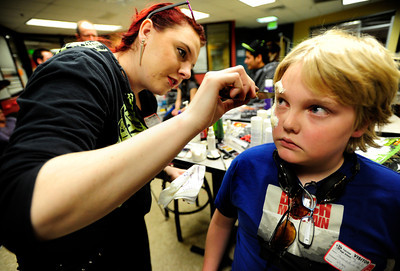 Theatrical Costumes, Ect. makeup artist Melinda Wolfe, 21, left, applies makeup to Josh Goode-Allen during the filming of an Awareness Drive week zombie video on Tuesday, Feb. 19, at Fairview High School in Boulder. The event was part of a video to bring awareness to problems such as substance abuse, cutting, stress, depression and eating disorders. For more photos and video of the zombie invasion at Fairview High School go to www.dailycamera.com DAILY CAMERA/ JESSICA CUNEO.