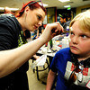 "Theatrical Costumes, Ect. makeup artist Melinda Wolfe, 21, left, applies makeup to Josh Goode-Allen during the filming of an Awareness Drive week zombie video on Tuesday, Feb. 19, at Fairview High School in Boulder. The event was part of a video to bring awareness to problems such as substance abuse, cutting, stress, depression and eating disorders. For more photos and video of the zombie invasion at Fairview High School go to  <a href=""http://www.dailycamera.com"">http://www.dailycamera.com</a> DAILY CAMERA/ JESSICA CUNEO."