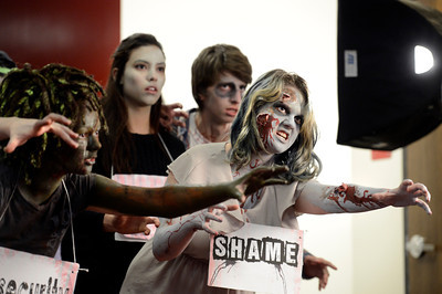 Fairview High School freshman Philippa Keosheyan, right, and freshman Sydney McViker, left, act like zombies during the filming of an Awareness Drive week zombie video on Tuesday, Feb. 19, at Fairview High School in Boulder. The event was part of a video to bring awareness to problems such as substance abuse, cutting, stress, depression and eating disorders. For more photos and video of the zombie invasion at Fairview High School go to www.dailycamera.com Jeremy Papasso/ Camera