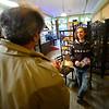 KRISTOPHER RADDER — BRATTLEBORO REFORMER<br /> Alexander Bobella, a server at Tulip Cafe, talks with Republican U.S. Senator candidate Lawrence Zupan as he visits local stores in downtown Brattleboro on Thursday, Nov. 1, 2018.