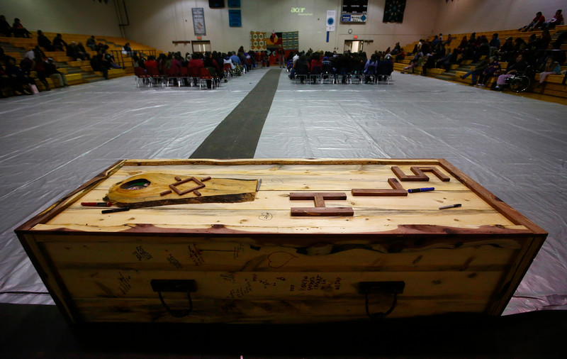 The coffin box for 14-year-old Henny Scott sits at the back of the gymnasium during the funeral service at Lame Deer High School in Lame Deer, Mont. on Saturday, Jan. 5, 2019. Scott was reported missing to the Bureau of Indian Affairs on Dec. 13. The Montana Department of Justice issued a Missing and Endangered Person Advisory on Dec. 26. She was found two days later.