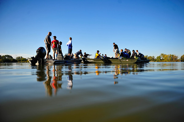 Members of the District 230 fishing club work with the Village of Orland Park to place fishing cribs in an effort to built up habitats at Lake Sedgewick, Tuesday, Sept. 23rd, 2014, in Orland Park.   Gary Middendorf/for Sun-Times Media