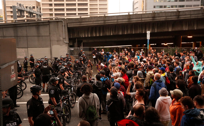 Protesters gather at the entrance to I-5 during a protest in downtown Seattle, WA on July 7, 2016. The protest was a reaction to the killing of Alton Sterling,  37-year-old black man, by two Baton Rouge police officers outside a convenience store in Louisiana two days earlier.