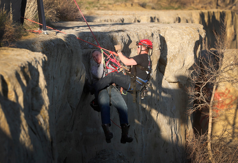 First responders work to raise Bridger Wilson after he fell from the Rims in Swords Park in Billings, Mont. on Thursday, April 18, 2019.