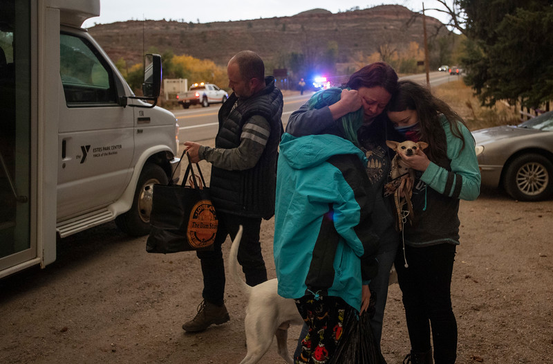 Melanie Luther embraces her two daughters Julie Luther and Alex Luther, after reuniting with them and her husband Bryan Luther after all three were stranded in Estes Park when the city was evacuated due to the East Troublesome Fire, now the second largest in Colorado history, at The Dam Store along U.S. Highway 34 near Loveland, Colo. on Thursday, Oct. 22, 2020.