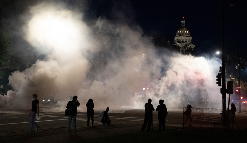 Tear gas rises from the streets in front of the Colorado Capitol during a protest in response to the police killing of George Floyd, an unarmed black man in Minneapolis, in Denver, Colo. on Friday, May 29, 2020.