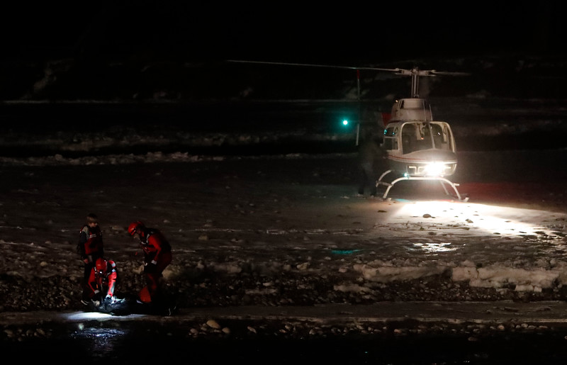 A Billings Fire Department swift water rescue team assists two boys that became stranded on an island in the Yellowstone River in Billings, Mont. on Friday, Jan. 4, 2019.