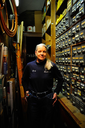 Judy Tuma, store manager at Jebens Hardware, stands by the stores supply of virtually ever size of nuts and bolts at Jebens Hardware, Wednesday, December 10th, 2014, in Blue Island. | Gary Middendorf/ Chicago Tribune Media Group