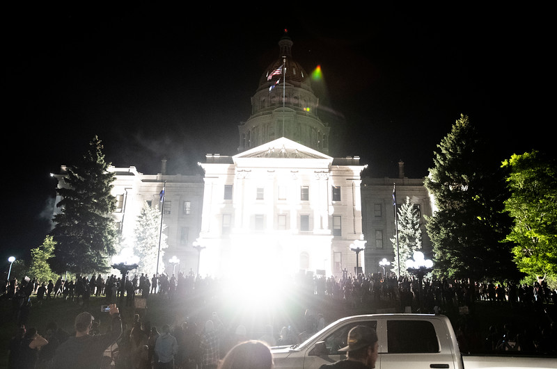 A flash bang grenade explodes in front of the Colorado Capitol during a protest in response to the police killing of George Floyd, an unarmed black man in Minneapolis, in Denver, Colo. on Friday, May 29, 2020.