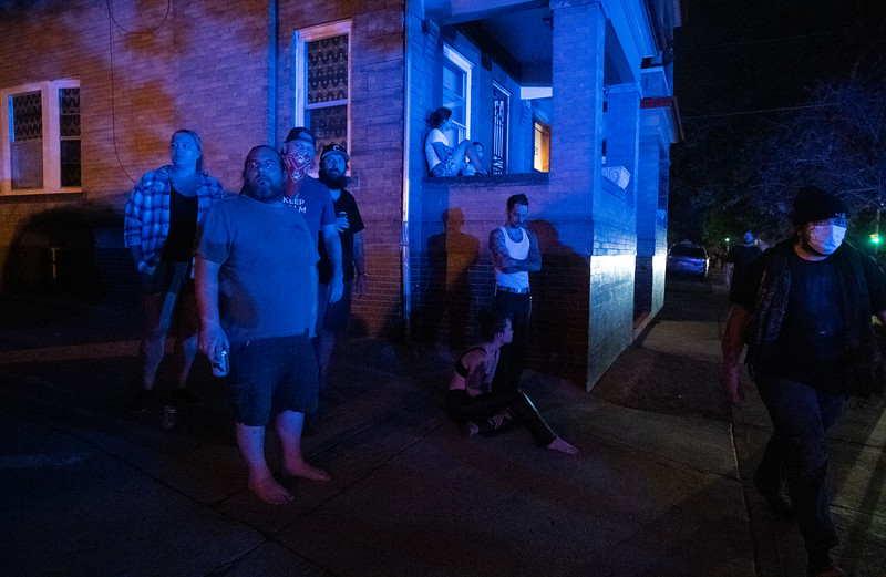 Residents congregate in front of their homes as they watch law enforcement encounter protesters during the third night of protests in response to the police killing of George Floyd, an unarmed black man in Minneapolis, in Denver, Colo. on Saturday, May 30, 2020.