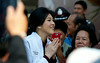 Former Prime Minister Yingluck Shinawatra greets her fans in Chiang Rai, Thailand