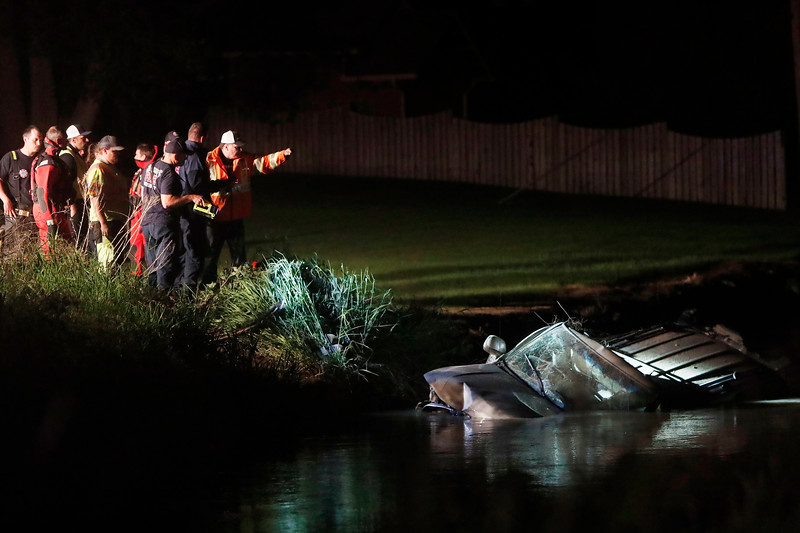 First responders work the scene of a fatal crash that left a vehicle partially submerged in the Billings Bench Water Association irrigation ditch near the intersection of U.S. Highway 312 and Dover Road in Billings, Mont. on Thursday, June 7, 2019.