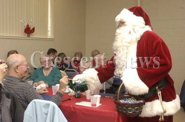 12-19-13 NEWS Senior Center Santa