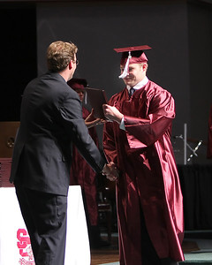 Andrew Murray is proud to receive his diploma