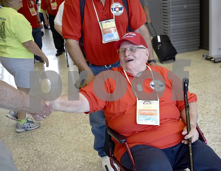 -Messenger photo by Chad Thompson <br> Gary Hendricks, of Humboldt, a U.S. Navy and U.S. Air Force veteran, is thanked as he makes his way through the Dulles International Airport in Washington, D.C. Saturday.