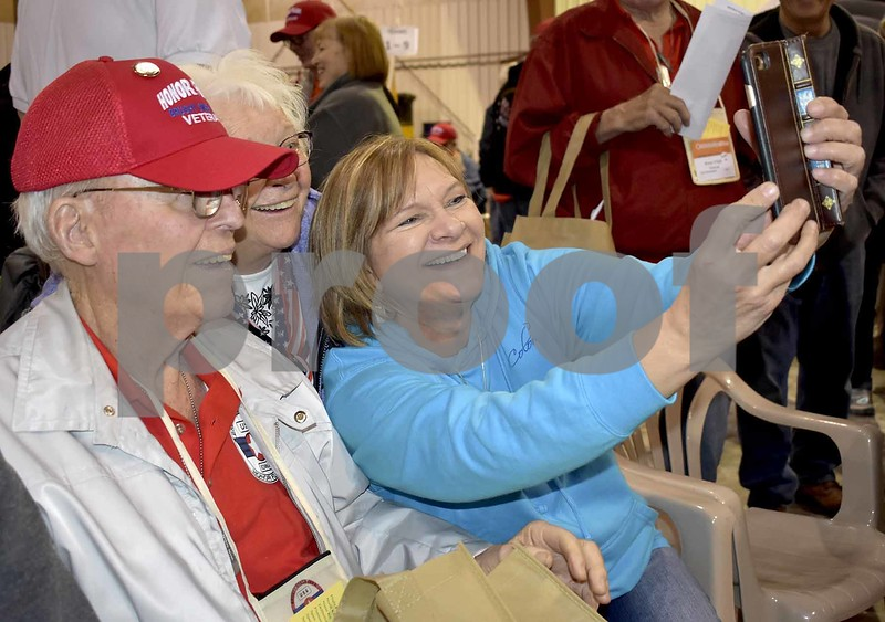 -Messenger photo by Chad Thompson <br> Leonard Walde, of Westside, a U.S. Army veteran, front, poses for a picture with his wife, Shirley Walde, center, and daughter, Wanda Conway, of Webster City, at the Fort Dodge Regional Airport Saturday morning.