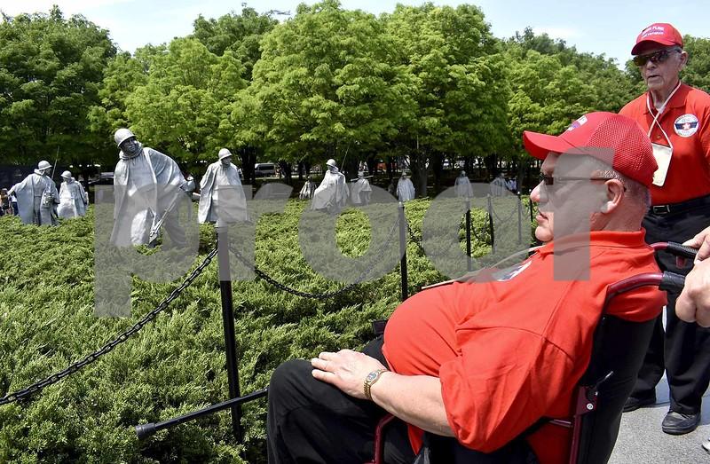 -Messenger photo by Chad Thompson <br> Richard Bredehoft, a U.S. Air Force veteran, looks on at the Korean War Veterans Memorial in Washington, D.C., Saturday.