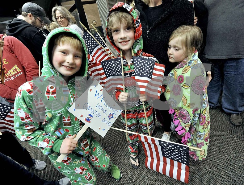 -Messenger photo by Hans Madsen<br /> <br /> Isaac Loynachan, 9, of Huxley, along with his brother Noah Loynachean, 10 wore their Christmas pajamas to welcome back their grandfather, Marine veteran Dave Gordon at the Fort Dodge Regional Airport Saturday night. Their sister, Viviana Loynachen, 7, opted for a colorful warm blanket instead.