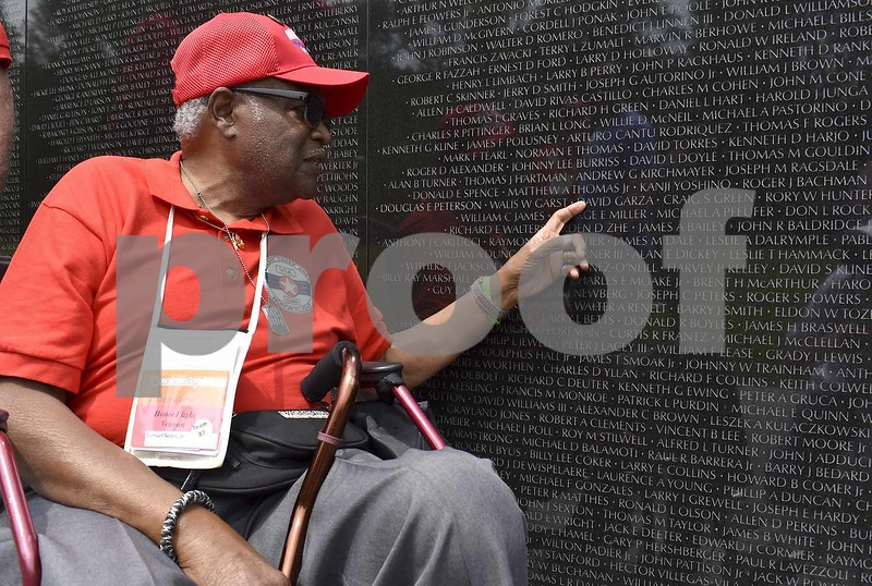 -Messenger photo by Chad Thompson <br> Samuel Sears Jr., of Ida Grove, a U.S. Air Force veteran, pays his respects to the thousands of men who were killed during the Vietnam War at the Vietnam Veterans Memorial in Washington, D.C. Saturday. Sears was a journalist in Vietnam from 1969-70.