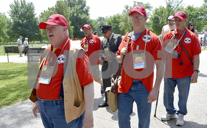 -Messenger photo by Chad Thompson <br> Three of the Edwards brothers make their way to the Vietnam Veterans Memorial Saturday in Washington, D.C. Pictured from left to right: Phil Edwards, of Oak Hill, California, a U.S. Marine Corps veteran, Norm Edwards, of Otho, a U.S. Army veteran, and Bob Edwards, of Sioux City, a Marine Corps veteran. Kevin Edwards, of Badger, a Marine Corps veteran, was also on the Brushy Creek Area Honor Flight.