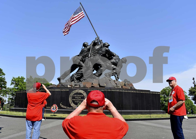 -Messenger photo by Chad Thompson <br> David Siebrecht, of Schaller, a U.S. Air Force veteran center, takes a photo of the Marine Corps War Memorial in Washington, D.C., Saturday evening.