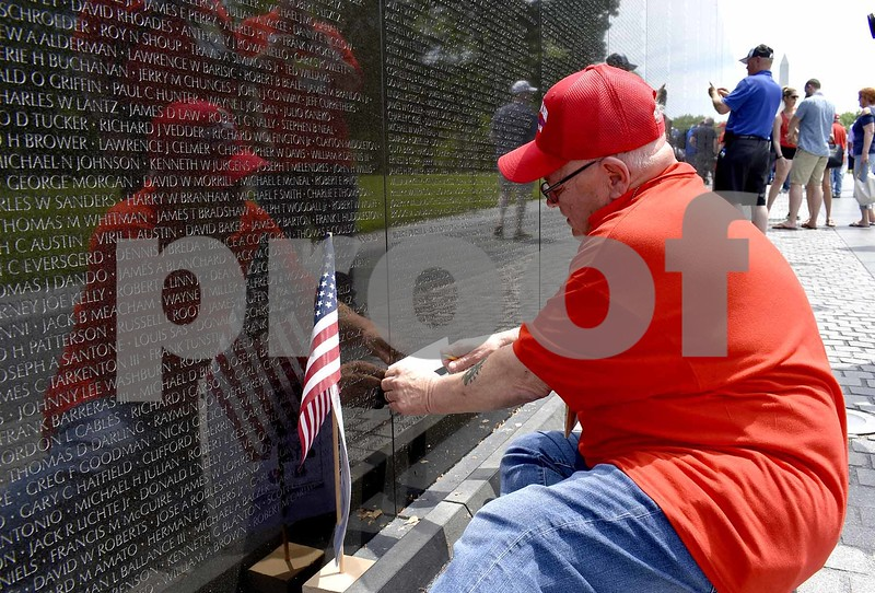 -Messenger photo by Chad Thompson <br> James Graham, of Webster City, a U.S. Air Force veteran, begins to trace the name of Jerry Dean Hatcher on the wall that makes up the Vietnam Veterans Memorial Saturday in Washington, D.C. Hatcher, a native of Humboldt, was killed in Vietnam in 1967.