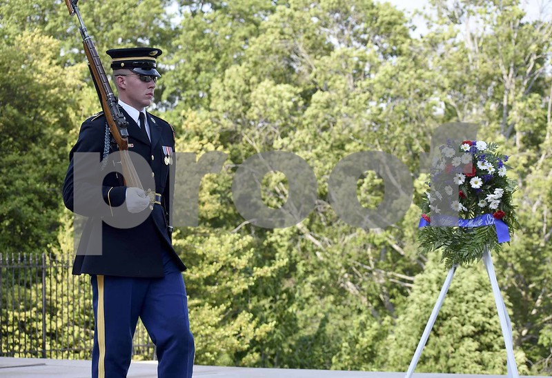 -Messenger photo by Chad Thompson <br> One of the guards at Arlington National Cemetery marches during the changing of the guard ceremony Saturday in Washington, D.C.