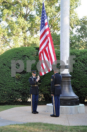 -Messenger photo by Joe Sutter<br /> <br /> Brushy Creek Area Honor Flight veterans watched the lowering of the flag for the day at Arlington National Cemetery.