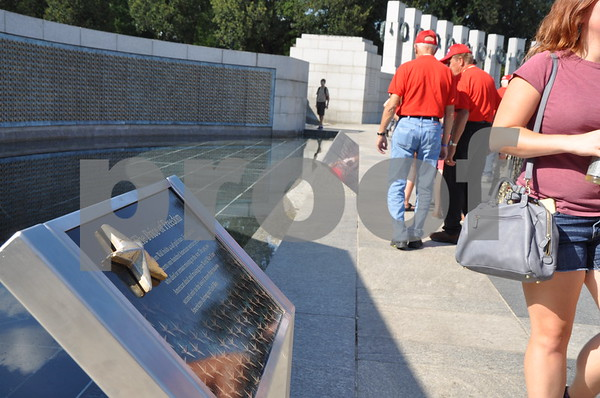 """-Messenger photo by Joe Sutter<br /> <br /> """"The Price of Freedom"""". The gold stars on this wall at the World War II Memorial are explained by this plaque at left. Each of the 4,048 stars on the wall represent 100 Americans who died in the war."""