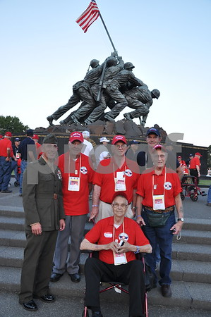 -Messenger photo by Joe Sutter<br /> <br /> Veterans from Hamilton County with First Lt. Matt Rojo, public affairs officer for the U.S. Marine Corps Base Quantico, at the Marine Corps War Memorial. This memorial shows the famous scene of marines raising the U.S. flag over Iwo Jima.