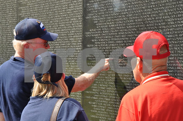 -Messenger photo by Joe Sutter<br /> <br /> Honor Flight guardians Andy Meredith and Tricia Zubrod, and Zubrod's father Merlyn Zubrod view the Vietnam War Memorial
