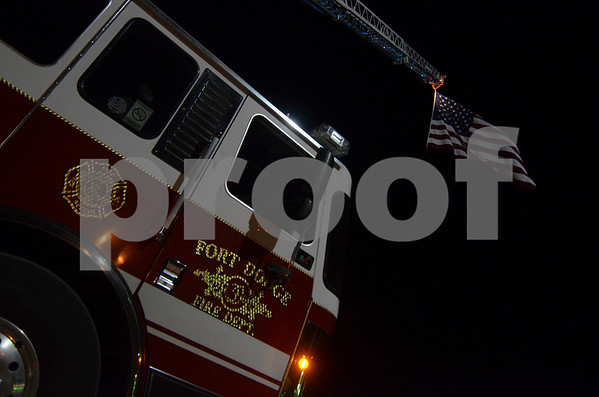 -Messenger photo by Jesse Major<br /> The Fort Dodge Fire Department flew their large American Flag at the Fort Dodge Regional Airport as the Brushy Creek Are Honor Flight returned from Washington, D.C., Saturday.