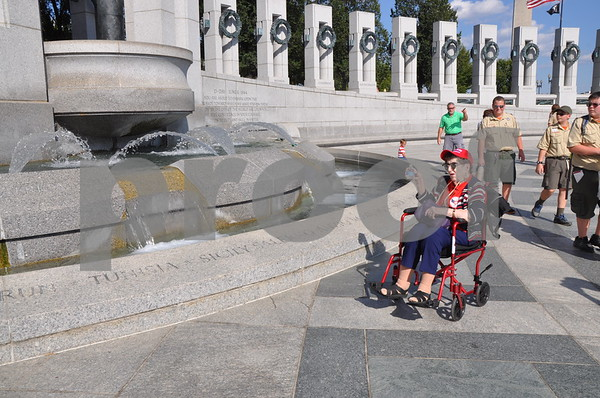 -Messenger photo by Joe Sutter<br /> <br /> World War II veteran Norma Willoughby points out locations noted on the fountain at the Atlantic arch in the World War II memorial.