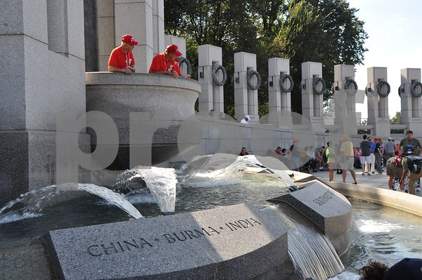 -Messenger photo by Joe Sutter<br /> <br /> Veterans overlook the fountains with names of important locations, as well as the central reflecting fountain at the World War II memorial