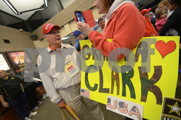-Messenger photo by Jesse Major<br /> John Clark, an Army Veteran who served during the Korean War, records a reaction video for his his friends and family who couldn't make it out to the Fort Dodge Regional Airport.