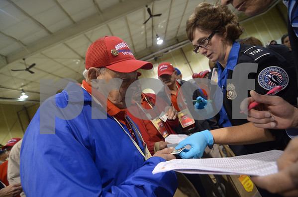 -Messenger photo by Jesse Major<br /> Glenn Doorenbos goes through security Saturday morning at the Fort Dodge Regional Airport before going on the Brushy Creek Area Honor Flight to Washington, D.C.