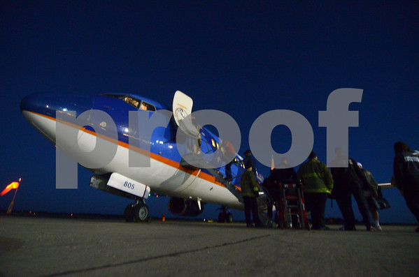 -Messenger photo by Jesse Major<br /> Veterans board the plane before flying to Washington, D.C., for the Brushy Creek Area Honor Flight on Saturday.