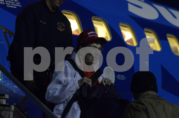 -Messenger photo by Jesse Major<br /> Norma Willoughby, a Royal Air Force veteran who served during World War II, is carried up the stairs to the plane taking her and 97 other veterans on the Brushy Creek Area Honor Flight on Saturday.