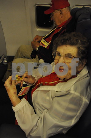 -Messenger photo by Joe Sutter<br /> <br /> World War II veteran Norma Willoughby shows off the challenge coin veterans were given on the flight back as a souvenir from the trip.