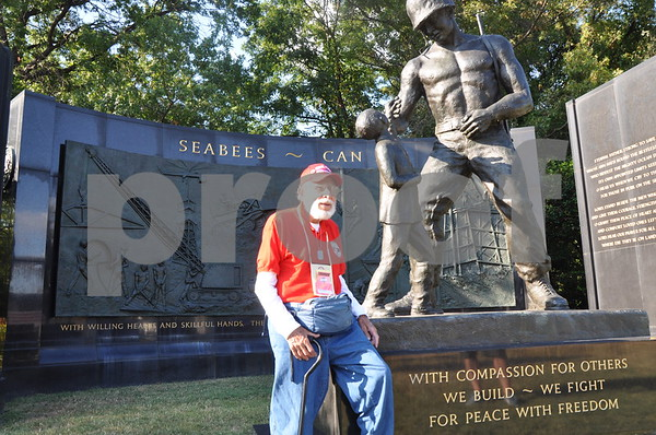 "-Messenger photo by Joe Sutter<br /> <br /> World War II veteran Haskel Valentine served as a Navy Seabee (in a CB, or construction brigade), and took a moment to stop here at the Seabees memorial just outside Arlington National Cemetery. The large slogan above him reads ""Seabees ~ can do."""