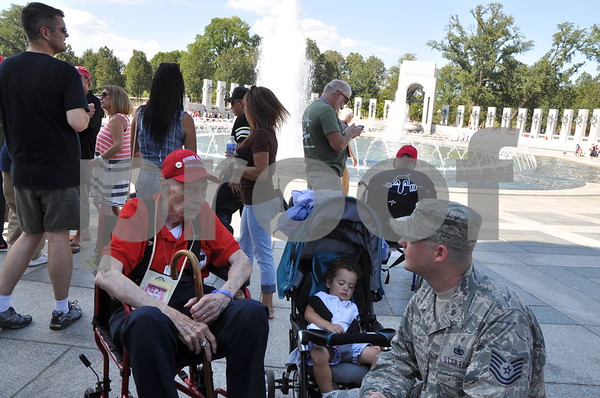 -Messenger photo by Joe Sutter<br /> <br /> World War II veteran William Lees visits with a U.S. Airman at the World War II memorial. Lees served in the Army Air Corps before the Air Force was created.