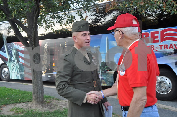 -Messenger photo by Joe Sutter<br /> <br /> First Lt. Matt Rojo, public affairs officer for the U.S. Marine Corps Base Quantico, greets Bill Foval and the other veterans as they arrive at the U.S. Marine Corps Memorial.