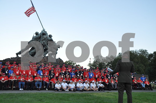 -Messenger photo by Joe Sutter<br /> <br /> Brushy Creek Area Honor Flight veterans are thanked by First Lt. Matt Rojo, public affairs officer for the U.S. Marine Corps Base Quantico, after taking a group photo at the Marine Corps War Memorial, which depicts the flag raising at Iwo Jima.