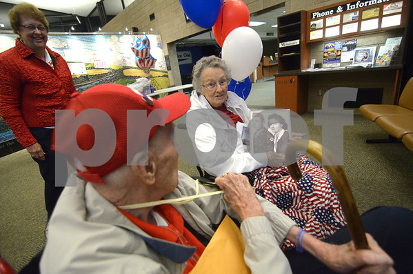 -Messenger photo by Jesse Major<br /> Inez Lees, right, of Boone, surprised her husband William Lees when he returned from the Brushy Creek Area Honor Flight on Saturday and brought a photo of the couple taken when they were younger. The two had their first date the day before Pearl Harbor was attacked.