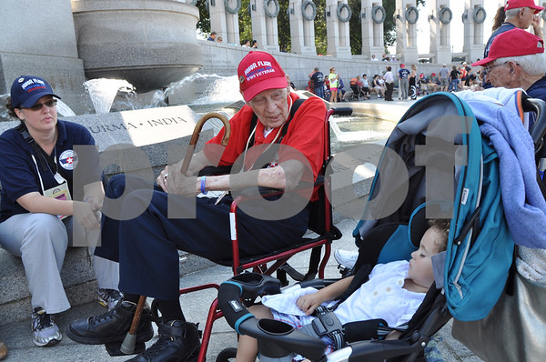 -Messenger photo by Joe Sutter<br /> <br /> World War II veteran Bill Lees visits the World War II memorial and is greeted by his family including great-grandson Julian Zemel, right. His granddaughter Sarah Phillips, left, was taking him around for the day.
