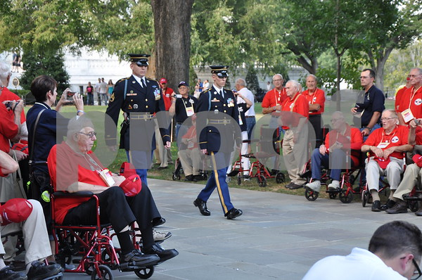 -Messenger photo by Joe Sutter<br /> <br /> Brushy Creek Area Honor Flight veterans watch as an honor guard comes to lower the flag for the day at Arlington National Cemetery.